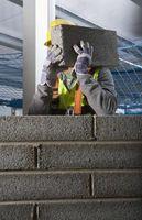 ¿Cuánta arena se requiere para colocar bloques de hormigón?