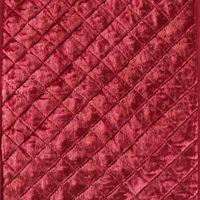 Cómo hacer un cabecero de tela con una barra de cortina