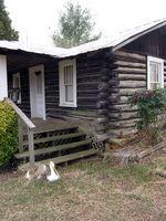 Cómo construir una terraza en una casa de troncos