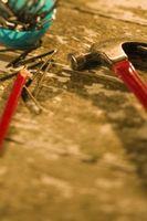 ¿Qué uñas uso a puesto encima de revestimiento de Masonite