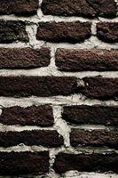 ¿Puede poner anclajes de concreto en ladrillo?