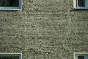 Cómo colocar un marco de puerta en una pared de hormigón