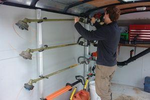 Cómo reemplazar la línea de la cadena en un artesano eléctrico orilladora Trimmer
